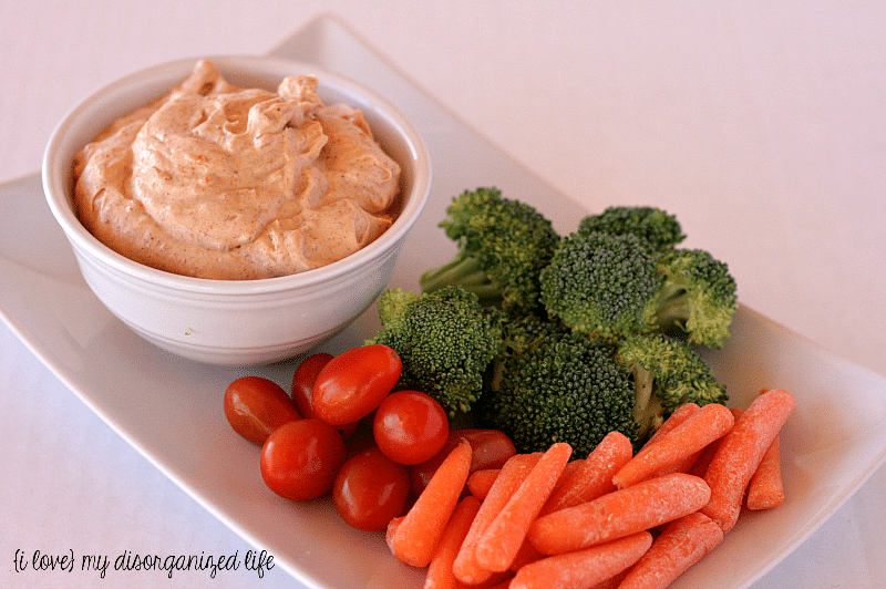 Easy Taco Dip with raw veggies for dipping