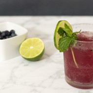 Roasted blueberry mojitos are a sweet summer twist on a classic cocktail. Roasting the blueberries enhances their sweetness, which contrasts with the tart lime juice.