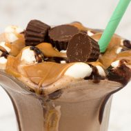 Boozy peanut butter s'mores milkshakes are an over-the-top decadent dessert, with chocolate, peanut butter, vodka, marshmallow and graham cracker.