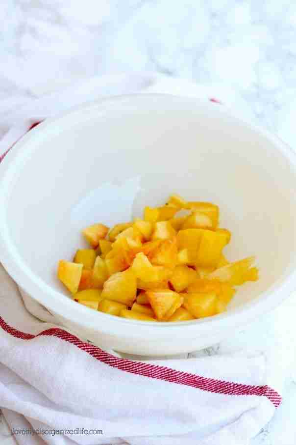 This peach ice cream recipe couldn't be easier to make with just 4 ingredients. Rich, creamy and loaded with fresh peaches, you'll be wanting more!