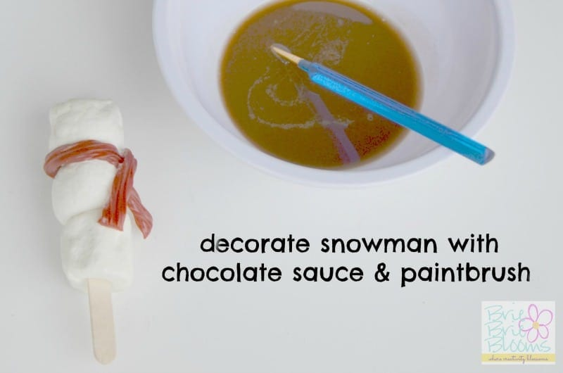 decorate snowman with paintbrush