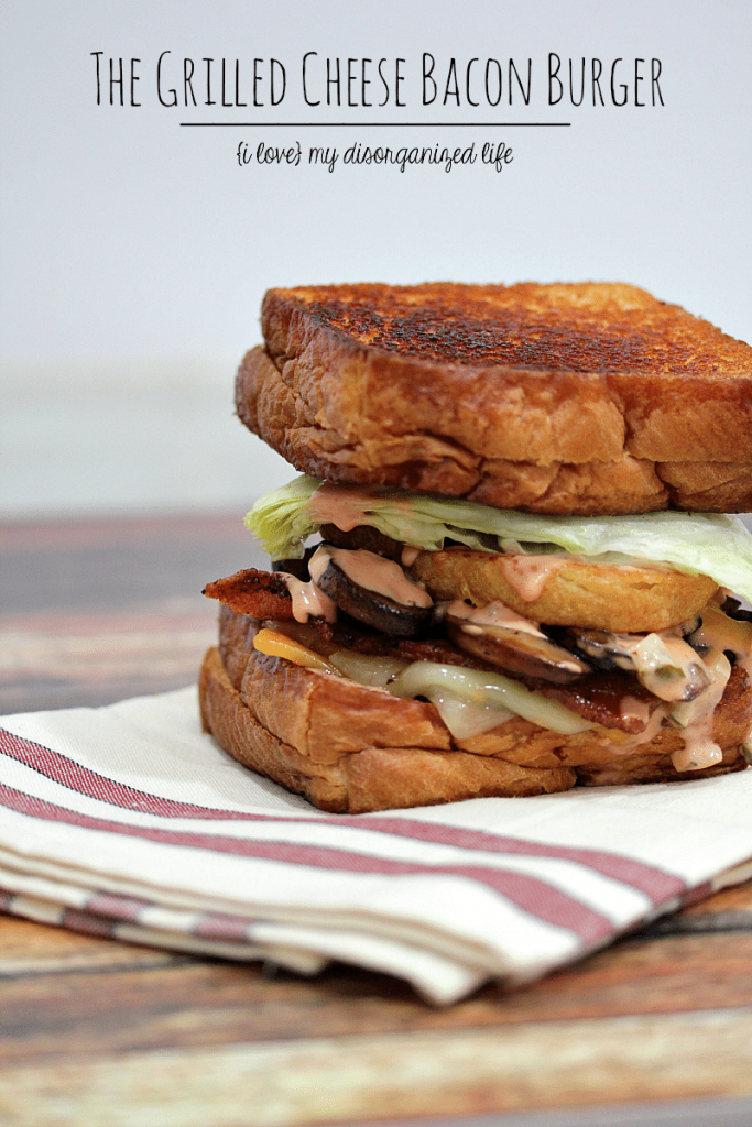 The grilled cheese bacon burger is a 1/3 hamburger patty topped with bacon, Cheddar, Swiss, mushrooms, onion rings, lettuce & secret sauce. Next, it's sandwiched between two Texas toast grilled cheese sandwiches. That's right. Grilled cheese sandwiches are in lieu of a plain 'ole bun. You're Welcome.