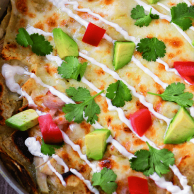 Too busy to cook this summer? These cheesy chicken chilaquiles are ready in less than 30 minutes and only require 5 ingredients!