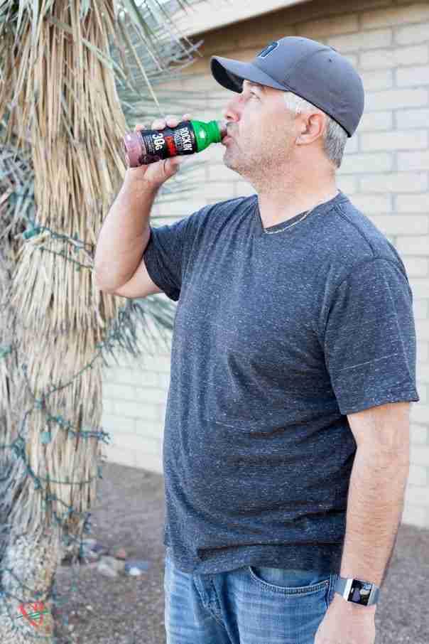 Man drinking Shamrock Farms Rockin Protein (spinach ham dip - spinach dip)