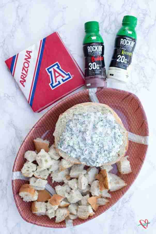 Spinach ham dip flat lay with Rockin Protein and U of A napkins