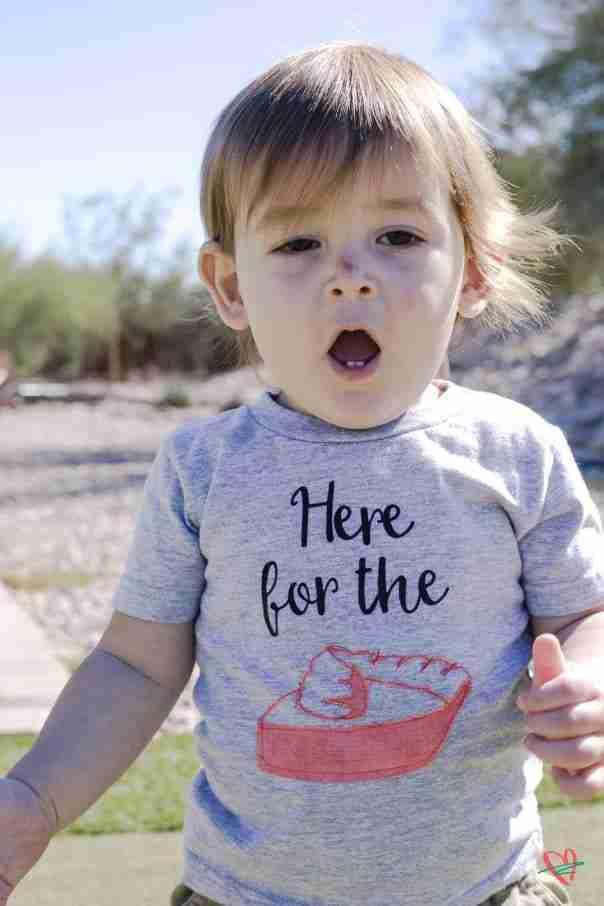 Close up of toddler wearing Thanksgiving tee