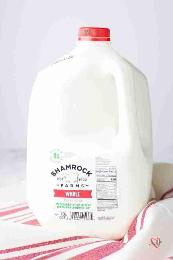 Closeup of gallon of whole milk used for coconut fudge cake